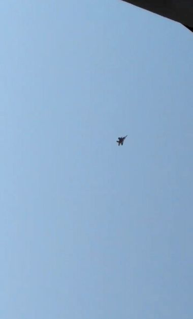 An F-15 jet flies overhead as it attempts to intercept a Horizon Air Bombardier Dash 8 Q400, which was reported to be hijacked, in Fircrest, Washington, the U.S. before crashing in the South Puget Sound, August 10, 2018, in this still image taken from a video obtained from social media. Leah Morse/via REUTERS THIS IMAGE HAS BEEN SUPPLIED BY A THIRD PARTY. MANDATORY CREDIT. NO RESALES. NO ARCHIVES.