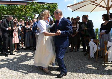 Austria's Foreign Minister Karin Kneissl dances with Russia's President Vladimir Putin at her wedding in Gamlitz, Austria, August 18, 2018. Roland Schlager/Pool via Reuters - UP1EE8I11VX18