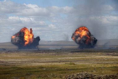5636148 13.09.2018 In this handout released by Russian Defence Ministry smokes from explosions rise over Tsugol training ground during Vostok-2018 (East-2018) military drills, Zabaikalsky Krai region, Russia, September 10, 2018. Vostok-2018 (East-2018) military drills are the biggest since a Soviet military exercise Zapad-81 (West-81) that took place in 1981. / Russian Defence Ministry, Image: 386536515, License: Rights-managed, Restrictions: , Model Release: no, Credit line: Profimedia, Sputnik