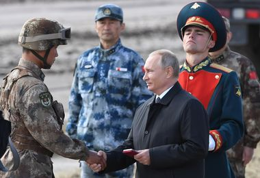 5636168 13.09.2018 Russian President Vladimir Putin awards an unidentified Chinese serviceman as he reviews troops during Vostok-2018 (East-2018) military drills at the Tsugol training ground, Zabaikalsky Krai region, Russia, September 13, 2018. Vostok-2018 (East-2018) military drills are the biggest since a Soviet military exercise Zapad-81 (West-81) that took place in 1981., Image: 386538575, License: Rights-managed, Restrictions: , Model Release: no, Credit line: Profimedia, Sputnik