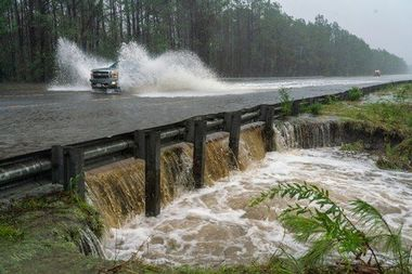A vehicle drives through water over a foot deep on route 17 during tropical storm Florence September 15, 2018 in Hampstead just outside of Wilmington, North Carolina. Tropical storm Florence is expected to drop more rain over the next few days and cause more flooding along North and South Carolina. Some rivers are expected to crest on Monday. Photo by /UPI, Image: 386898759, License: Rights-managed, Restrictions: , Model Release: no, Credit line: Profimedia, UPI