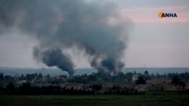 Smoke rises from a village near Baghouz, Syria, in this still image taken from a video by ANHA released March 2, 2019. ANHA/ReutersTV via REUTERS. THIS IMAGE HAS BEEN SUPPLIED BY A THIRD PARTY. MANDATORY CREDIT. NO RESALES. NO ARCHIVES. DO NOT REMOVE OR OBSCURE LOGO