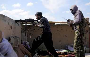 A fighter of Syrian Democratic Forces (SDF) fires a weapon in Baghouz, Deir Al Zor province, Syria March 3, 2019. REUTERS/Rodi Said