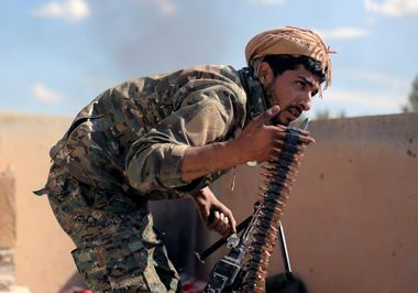 A fighter of Syrian Democratic Forces (SDF) carries ammunition in Baghouz, Deir Al Zor province, Syria March 3, 2019. REUTERS/Rodi Said