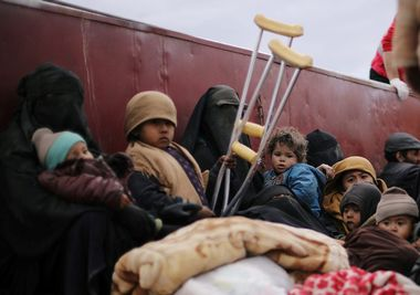 FILE PHOTO: Children sit at a back of a truck near the village of Baghouz, Deir Al Zor province, Syria February 27, 2019. REUTERS/Rodi Said/File Photo