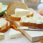 Slice of bread with cream cheese and butter for breakfast