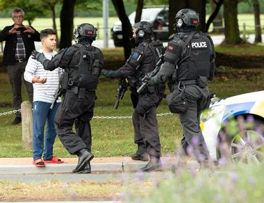 AOS (Armed Offenders Squad) push back members of the public following a shooting at the Masjid Al Noor mosque in Christchurch, New Zealand,, March 15, 2019. REUTERS/SNPA/Martin Hunter ATTENTION EDITORS - NO RESALES. NO ARCHIVES
