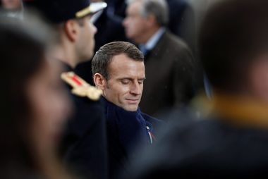 French President Emmanuel Macron stands at the Tomb of the Unknown Soldier as he attends a commemoration ceremony for Armistice Day, 100 years after the end of the First World War at the Arc de Triomphe in Paris, France, November 11, 2018. REUTERS/Benoit Tessier/Pool