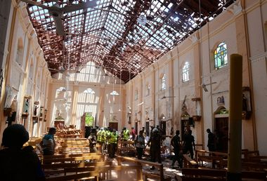 ATTENTION EDITORS - VISUAL COVERAGE OF SCENES OF DEATH AND INJURY Crime scene officials inspect the site of a bomb blast inside a church in Negombo, Sri Lanka April 21, 2019. REUTERS/Stringer NO ARCHIVES. NO RESALES. TEMPLATE OUT