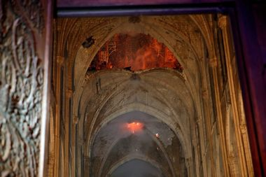 Flames and smoke are seen as the interior continues to burn inside the Notre Dame Cathedral in Paris, France, April 16, 2019. REUTERS/Philippe Wojazer/Pool
