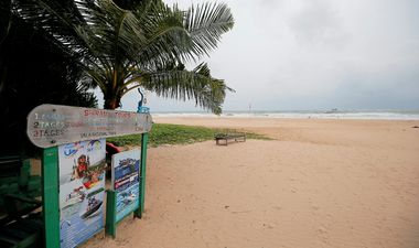 An empty beach is seen near a sign of the boat safari and whale watching center in a tourist area in Bentota, Sri Lanka May 2, 2019.Picture take May 2, 2019. REUTERS/Dinuka Liyanawatte