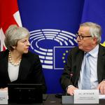 FILE PHOTO: British Prime Minister Theresa May and European Commission President Jean-Claude Juncker look at each other during a news conference in Strasbourg