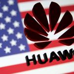 FILE PHOTO: A 3D printed Huawei logo is placed on glass above displayed U.S. flag in this illustration