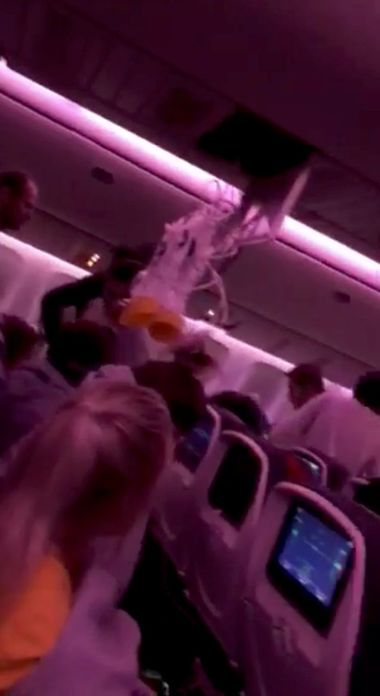 Oxygen masks fall during turbulence in the Air Canada AC 33 flight while in mid-Pacific, around 1500 km from Hawaii according to source, July 11, 2019 in this image obtained from social media. Australian Band Äi Hurricane Fall via REUTERS ATTENTION EDITORS - THIS IMAGE HAS BEEN SUPPLIED BY A THIRD PARTY. NO RESALES. NO ARCHIVES. MANDATORY CREDIT
