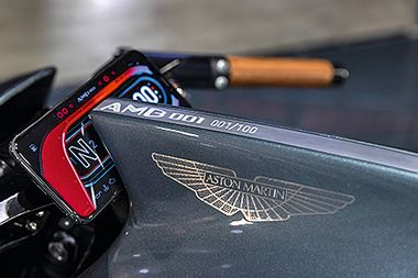 A limited edition model number marking sits on the AMB 001 motorcycle on display at the Aston Martin Lagonda Global Holdings Plc stand at the EICMA Motorcycle Show in Milan, Italy, on Nov. 6, 2019. Aston Martin debuted the 180-horsepower motorcycle, coming with a V-twin, turbo-charged engine, made in partnership with Brough Superior at the show. Photographer: Camilla Cerea/Bloomberg via Getty Images